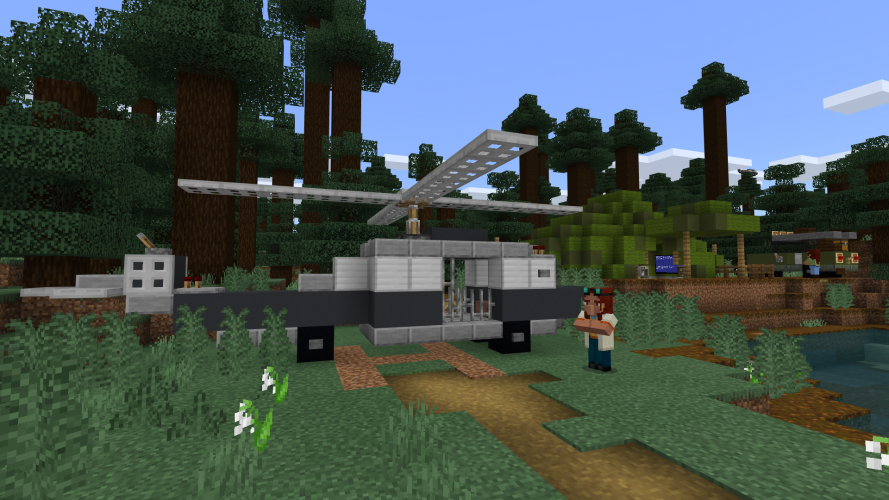 A person stands next to a helicopter in Minecraft: Education Edition