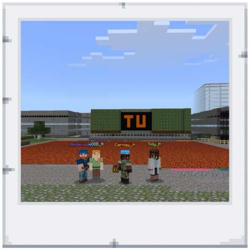 Four people stand in front of the Teesside University virtual campus in Minecraft: Education Edition