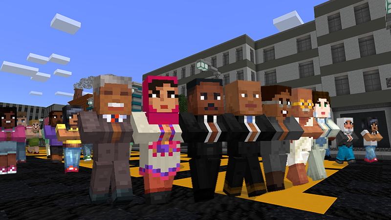 A troop of social justice and civil rights leaders march down a street.