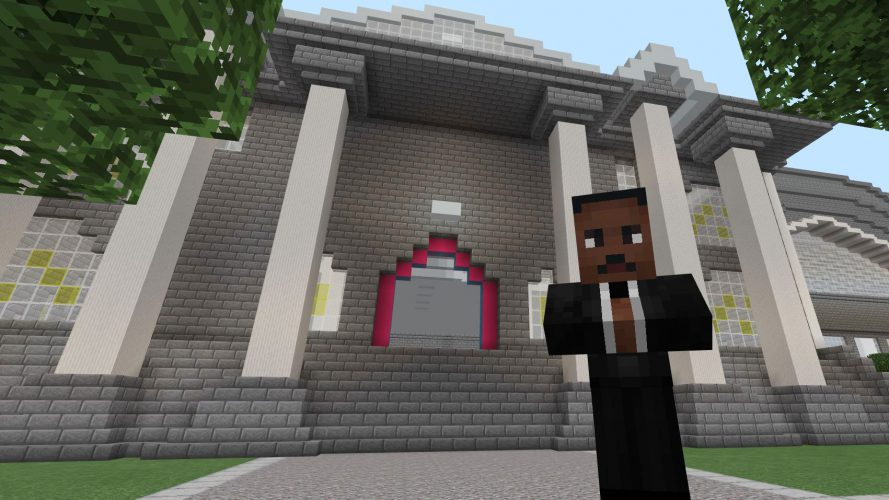 Martin Luther King Jr. stands in front of a columned museum entrance.