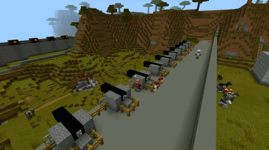 A line of cannons along a stone fortification in Minecraft: Education Edition