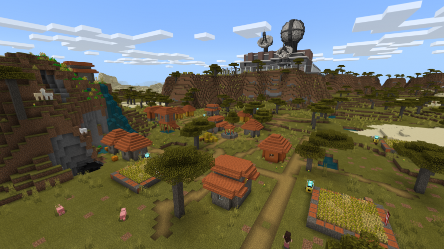 A satellite control compound sits on a mountain overlooking a village in a valley in Minecraft: Education Edition